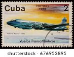 "Small photo of Moscow, Russia - July 14, 2017: A stamp printed in Cuba shows passenger airliner Douglas DC-4, Airline Havana-Madrid (1948), series ""The Cubana Airlines Transatlantic Flights"", circa 1988"