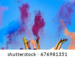 at the color holi festival ... | Shutterstock . vector #676981351