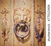 Rusty Metal Door Knocker In...