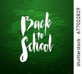 text back to school   hand... | Shutterstock .eps vector #677022829