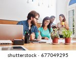students working in teamwork on ... | Shutterstock . vector #677049295