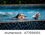 Small photo of child girl drowning in pool.