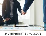 two business men shaking hands... | Shutterstock . vector #677066071