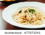 fettucine white cream sauce... | Shutterstock . vector #677073241