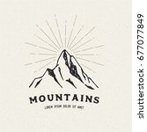 hand drawn mountains. sketch... | Shutterstock .eps vector #677077849