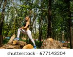 sporty fit girl is practicing... | Shutterstock . vector #677143204