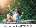 beautiful caucasian girl eating ... | Shutterstock . vector #677155111