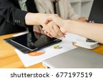 business partnership handshake... | Shutterstock . vector #677197519