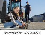woman in accident at workplace | Shutterstock . vector #677208271