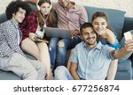 happy young people taking photo | Shutterstock . vector #677256874