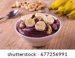 brazilian acai into a bowl over ... | Shutterstock . vector #677256991