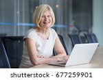 cheerful senior businesswoman... | Shutterstock . vector #677259901
