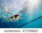 young girl in swimming pool | Shutterstock . vector #677290825