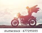 biker man with his motorbike... | Shutterstock . vector #677295355