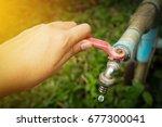 hand shut the faucet  water... | Shutterstock . vector #677300041