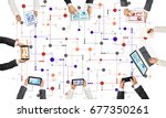 group of people with devices in ... | Shutterstock . vector #677350261