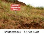 beware dangerous cliffs sign at ... | Shutterstock . vector #677354605
