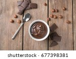 bowl with delicious chocolate... | Shutterstock . vector #677398381