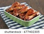 baked chicken legs | Shutterstock . vector #677402305