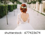 bride with red hair and wreath | Shutterstock . vector #677423674