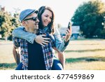 happy young couple using mobile ... | Shutterstock . vector #677459869