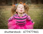 Young Child Girl Making Faces...