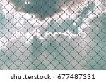 wire fence | Shutterstock . vector #677487331