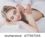 young woman lying on a massage... | Shutterstock . vector #677507245