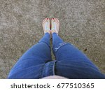close up of bare feet with red... | Shutterstock . vector #677510365