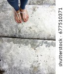 close up of bare feet with red... | Shutterstock . vector #677510371