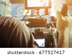 cameraman with his video camera ... | Shutterstock . vector #677527417