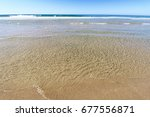 Small photo of Clear Ocean and Sand