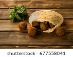 falafel balls in a pita and... | Shutterstock . vector #677558041