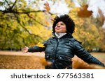 smiling carefree woman in... | Shutterstock . vector #677563381