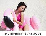 beautiful girl in a pink...   Shutterstock . vector #677569891