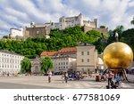 Small photo of Hohensalzburg Castle and Chapter Square (Kapitelplatz) with sculpture 'Sphaera' by Stephan Balkenhol - Salzburg, Austria, 10 July 2012