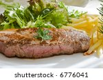 grilled beef steak with green salad and fried - stock photo