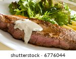 grilled beef steak with green salad and blue cheese sauce - stock photo