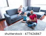 happy family. father  mother... | Shutterstock . vector #677626867