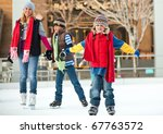 A Family Skates Together At An...
