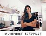 professional woman hairdresser...   Shutterstock . vector #677644117
