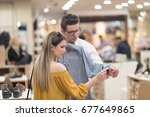 attractive couple shopping in a ... | Shutterstock . vector #677649865