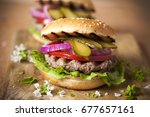 burger with grilled meat and... | Shutterstock . vector #677657161