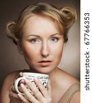 beautiful woman drinking coffee.... | Shutterstock . vector #67766353