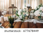 decorated table for a dinner... | Shutterstock . vector #677678449