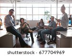 group of a young business... | Shutterstock . vector #677704969