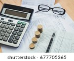 stacked of coins with... | Shutterstock . vector #677705365