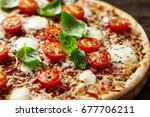 pizza with halved cherry... | Shutterstock . vector #677706211