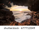watching the sunset through the ... | Shutterstock . vector #677712049