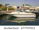 white yachts in the port... | Shutterstock . vector #677747011